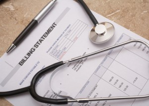 A billing statement, a pen and a stethoscope.